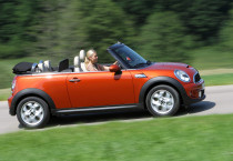 Red Mini Cooper Driving - Red Mini Cooper Driving