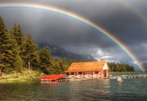 Rainbow-Over-Boathouse-on-Lake