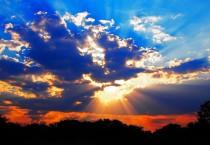 Rays of Setting Sun Shining Through Clouds