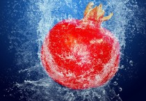 Red Pomegranate Dropped in Water