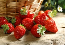 Red Strawberries at the Base of Wicker Basket