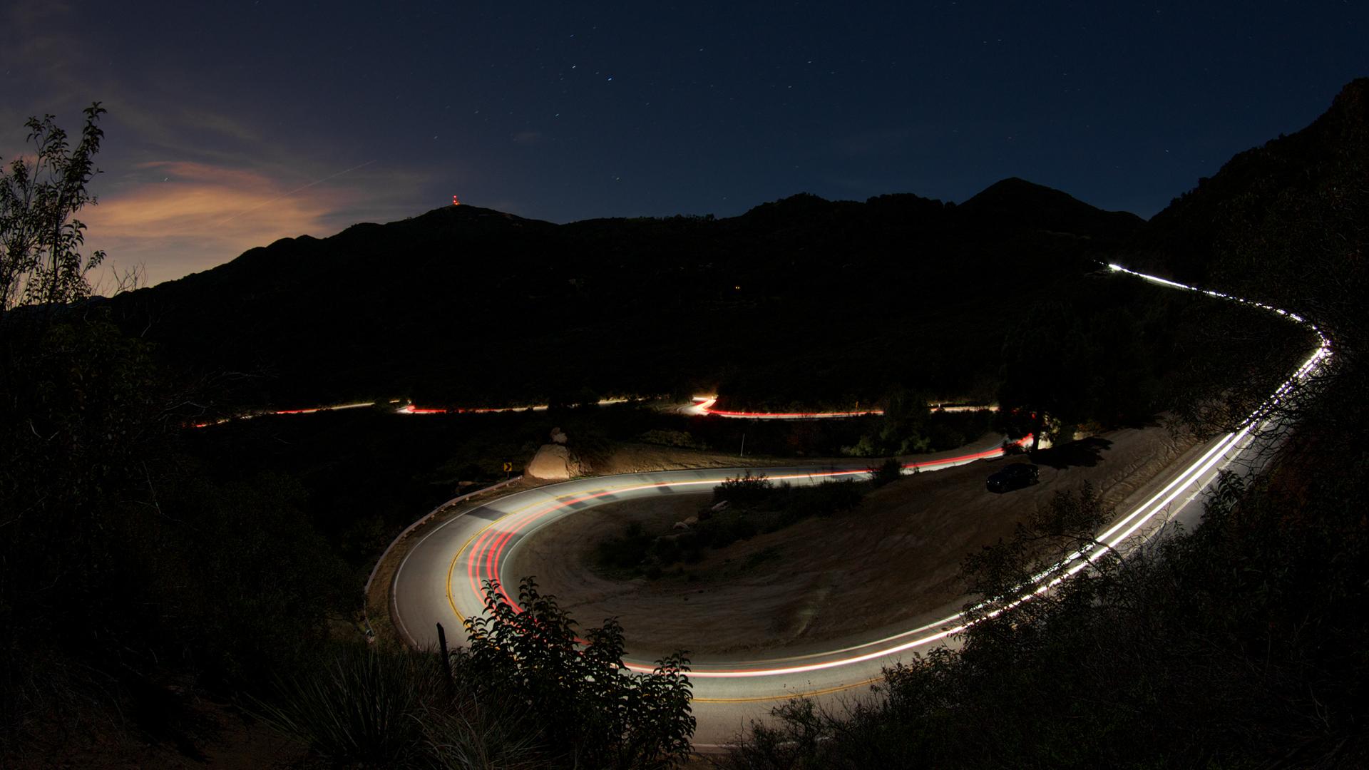 Time Lapse Hairpin Turn At Night Cars